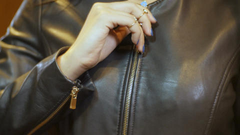 Closeup Woman in Black Jacket Opens and Closes Zipper Footage