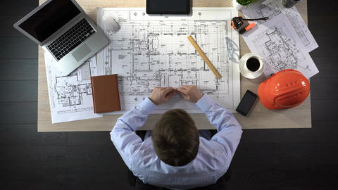 Representative of construction company preparing drawing of office building Footage