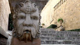 Spain Palma de Mallorca 027 gargoyle with a face on stair to old town Footage