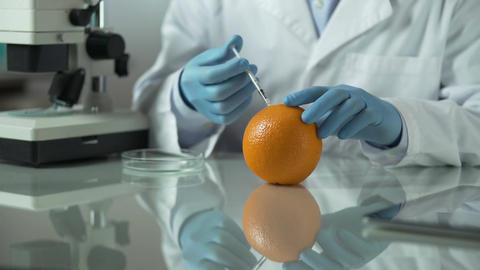 Scientist preparing anti-cellulite extract from orange peel, cosmetic laboratory Footage