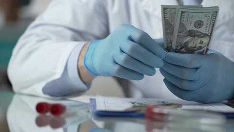 Laboratory researcher counting money received for invention of unique medicine Footage