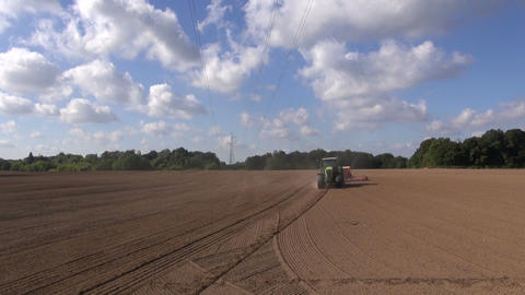 agriculture tractor sowing wheat crop in farm field. Panevezys district, Lithuan Footage