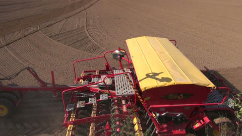 agriculture tractor sowing wheat crop in farm field Footage