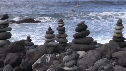 Structure of lava pebbles by the ocean Footage