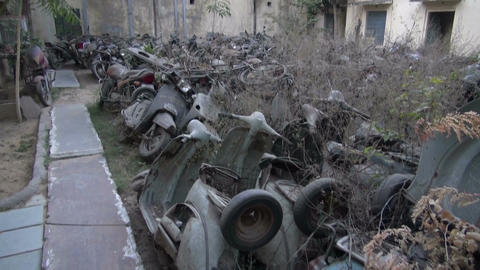 graveyard used discarded motorcycles motorbike for recycle, India Live Action