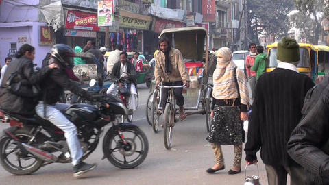 People on street with lot of motorcycles and bicycles in ancient sacred indian c Footage