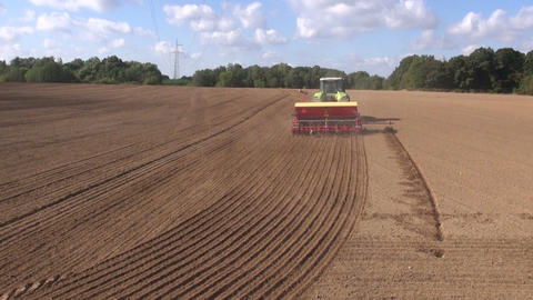 modern tractor sowing wheat crop in field Footage