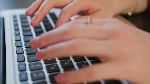 Female Hands Typing Text on Laptop Keyboard Footage