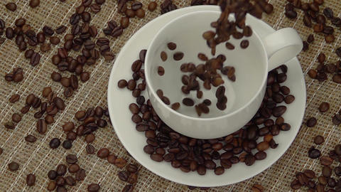 Whole Coffee Beans Falling into the Cup Footage
