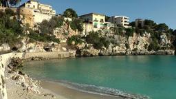Spain Mallorca Island small town Porto Cristo 022 rough shore of city center Footage