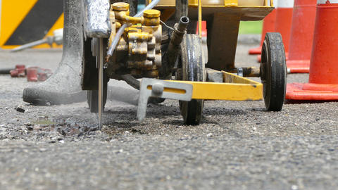 working with asphalt cutter Footage