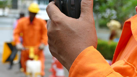 Walkie Talkie or Portable radio transceiver in Road construction work Live Action