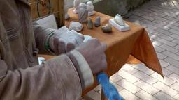 Spain Mallorca Island Sineu village 030 on a market, hands work on soapstone Footage