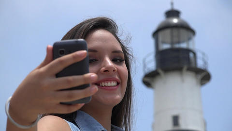 Teen Girl Selfie With Lighthouse Live Action