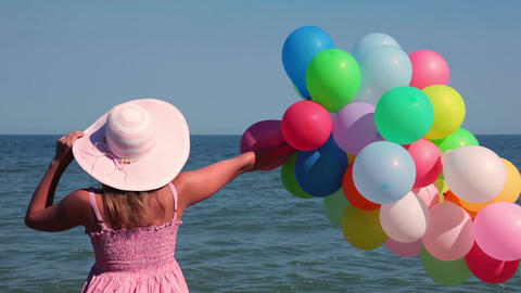 Girl with Balloons on the Beach 画像