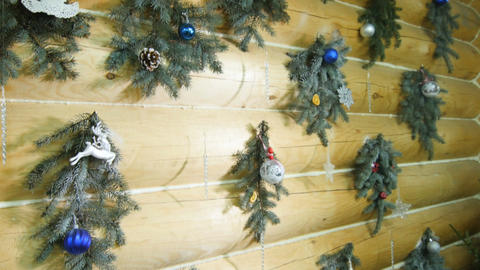 Wooden House Wall Decorated with Christmas Pine Branches Footage