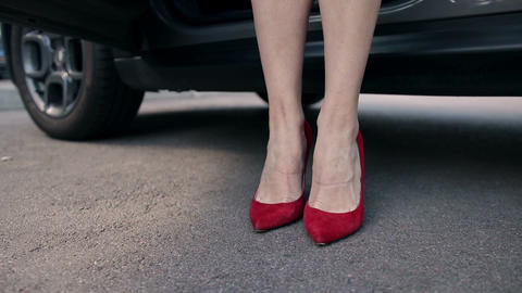 Sexy legs in high heels shoes getting out from car Footage