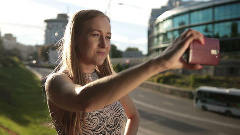 Adorable woman taking selfie with mobile phone Filmmaterial