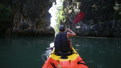 man backside view rows on kayak out to sea Footage