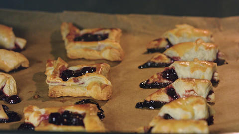 Bagels with Cherries Baked in Oven Footage