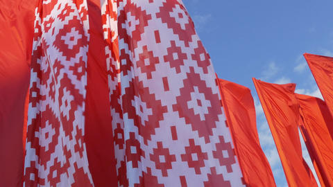 4K Ungraded: Red and White Flags With Belarusian National Pattern Fluttering In Footage