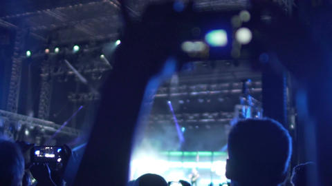 Happy fan shooting video at music concert, enjoying favorite band performance Footage