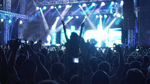 Inspired crowd dancing to music rhythm at music concert, extra slow motion Footage