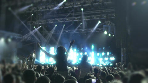 Young people dancing to beats of favorite music at concert, super slowmotion Footage