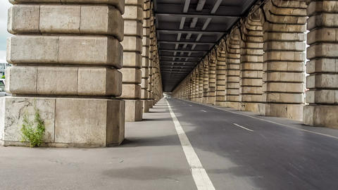 Cycling lanes running between arches of Pont de Bercy in Paris, time-lapse Footage