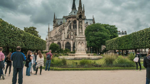 Wedding couples posing in garden near Notre-Dame de Paris Cathedral, timelapse Footage