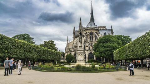 Notre-Dame de Paris garden with fountain, visitors viewing landmark, timelapse Footage