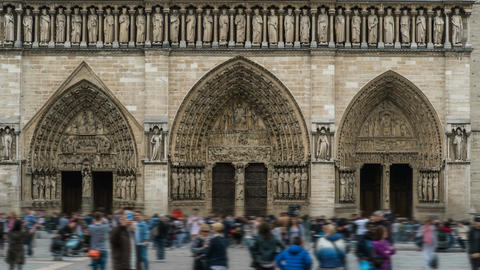 Main entrance to Notre-Dame de Paris with crowd of tourists in front, time-lapse Footage