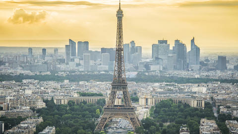 Eiffel Tower in Paris, modern business centers at back, urban life time-lapse Footage