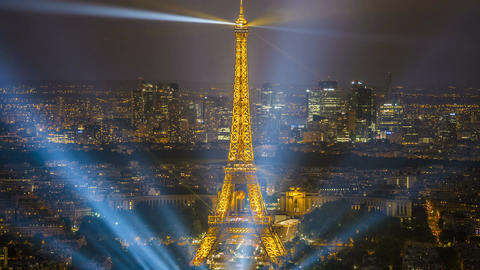 Paris center at night with illuminated Eiffel Tower and skyscrapers, time-lapse Footage