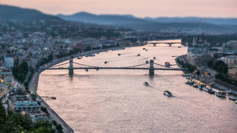 River with bridges and cruise ships sailing, sky reflection in water, urban view Footage