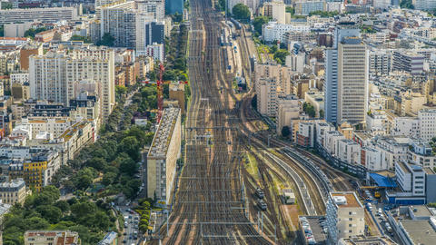 Trains running railway tracks in city, active traffic in megalopolis, time-lapse Footage