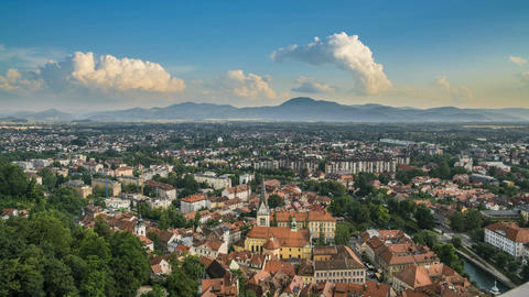 Aerial view of old European city, mountains on horizon, travel destination Footage