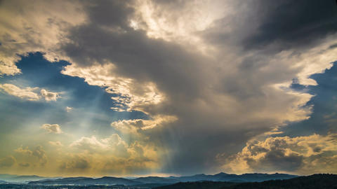 Sun shining brightly through clouds in heavenly sky, god blessing, timelapse Footage