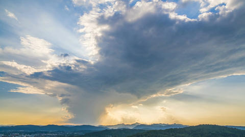Glowing sky with clouds flying above mountains, heavenly sunrise, timelapse Footage
