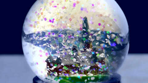 1080p Christmas Snow Globe With Colorful Artificial Snowflakes Falling Near Old Footage