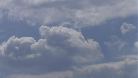 4K Cumulus Clouds Move Through Blue Sky on Summer Day Footage