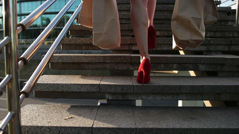 Elegant legs of woman with shopping bags on stairs Footage