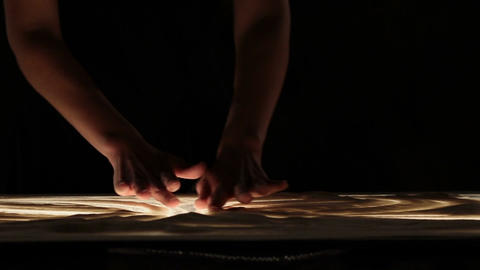 Woman's hands making sand painting Footage