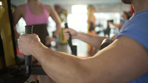 Man working out in gym, attracting attention of beautiful blonde woman, flirt Footage
