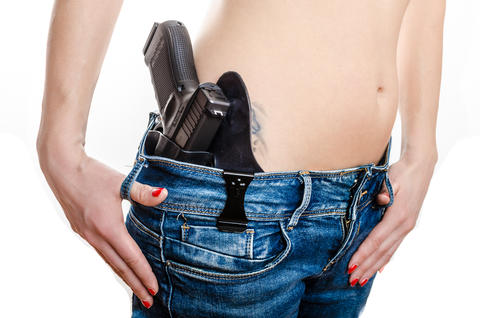 Concealed carry gun in his waistband Photo