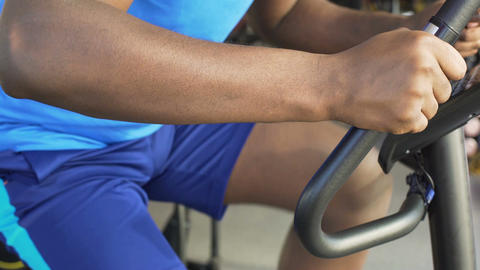 Athletic male riding a stationary bike in the fitness club, sport and health Footage