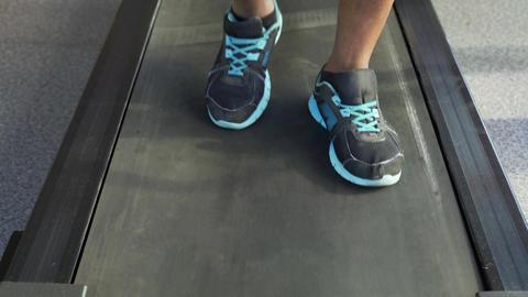 Rehabilitation, senior African-American man walking on treadmill in the gym Footage