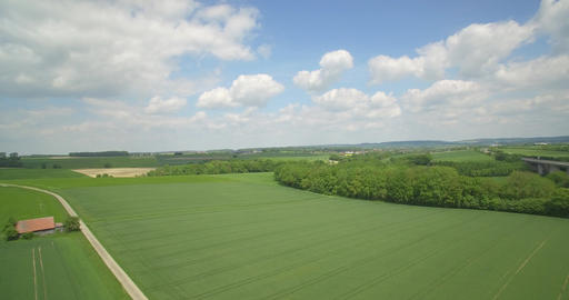 Aerial, High Speed Flight Above High Gras And Farmland, Germany