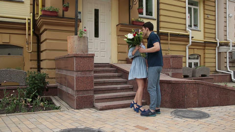 Young woman receiving bunch of flowers on a date Footage
