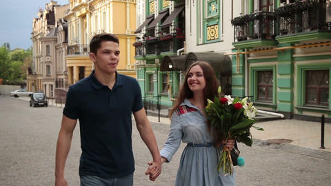Romantic couple in love strolling down city street Footage
